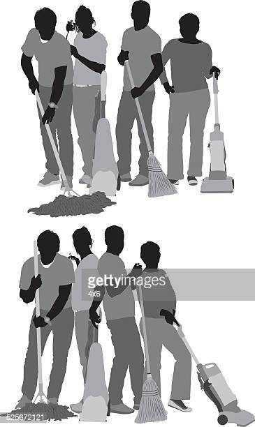 Group of people cleaning floor