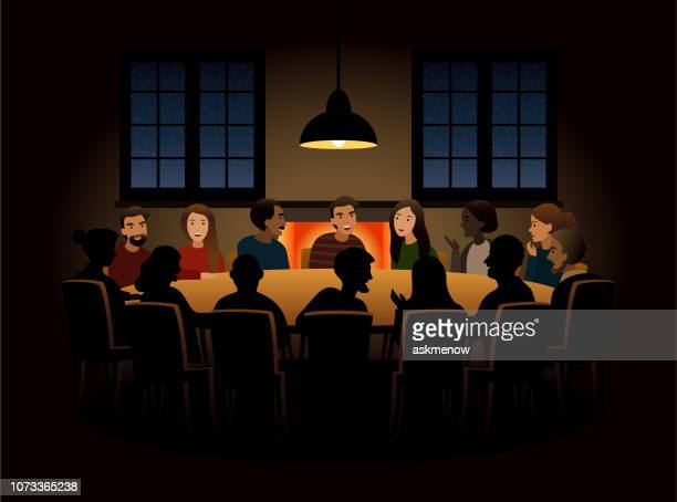 Group of people having a discussion at a round table