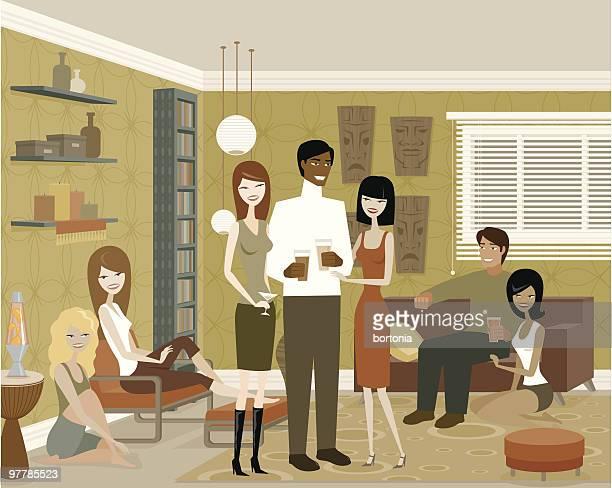人々の集まりのリビングルームでのパーティー