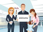 A group of people meet someone in the airport hall, welcome, hello.
