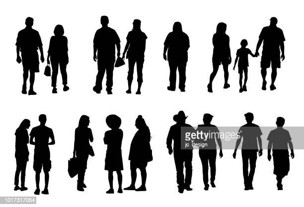Group of people silhouettes walking