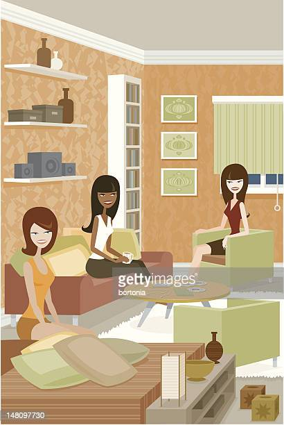 Group of Women Sitting Around and Talking in Living Room