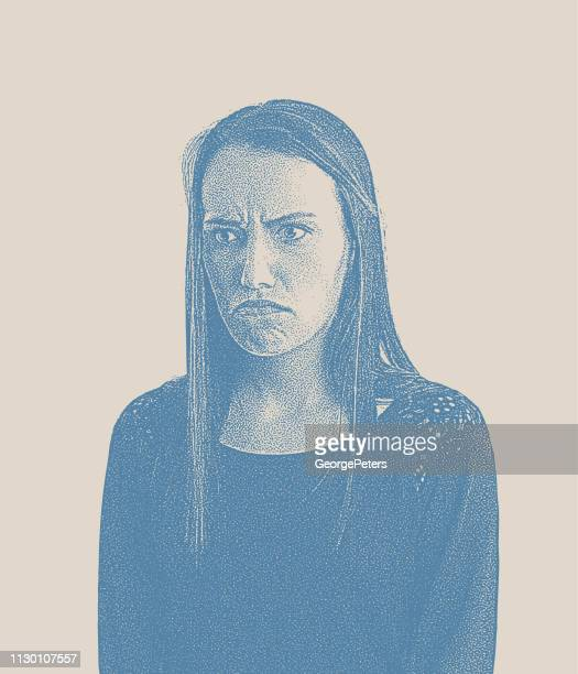 Grumpy young woman with angry facial expression