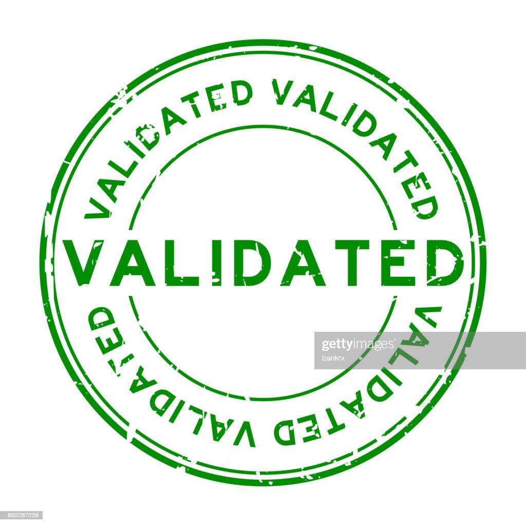 Grunge green validate round rubber stamp on white background