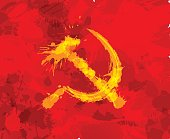 Grunge hammer and sickle symbol of communism on red background