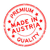Grunge red premium quality made in Austria round rubber seal stamp on white background