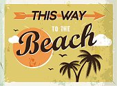 Grunge retro metal sign. This way to the beach.