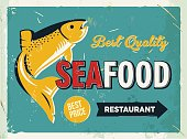 Grunge retro metal sign with seafood logo. Vintage poster.