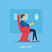 Guy is sitting on the plane. Flat design vector illustration.