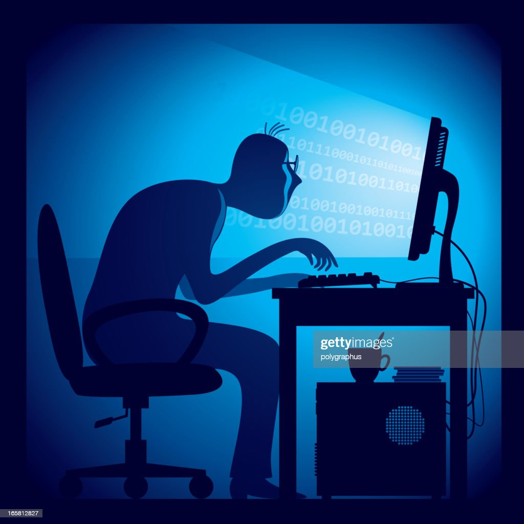 Hacker hard at work hunched over a keyboard