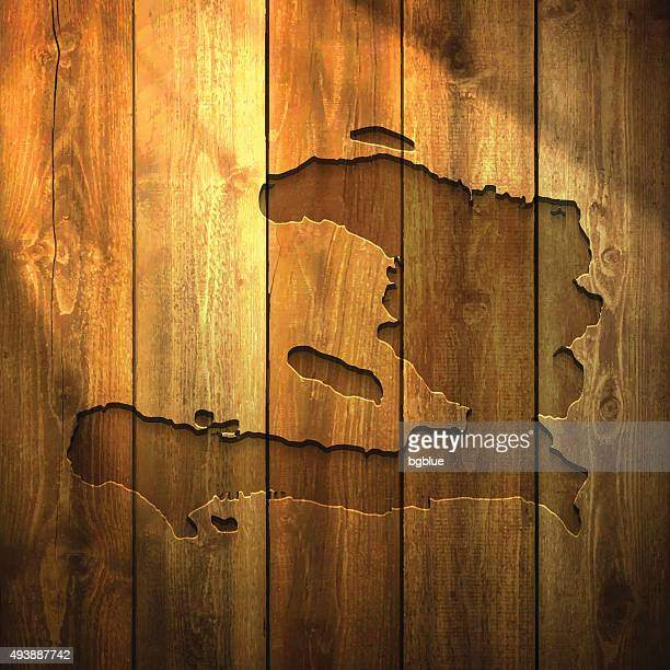 Haiti Map on lit Wooden Background