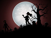 Halloween background with zombies and the moon on the cemetery