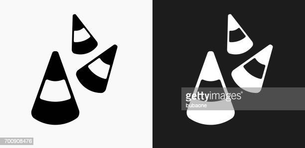 Halloween Candy Corn Icon on Black and White Vector Backgrounds