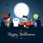 Halloween card with costumed children at a cemetery