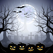 Halloween graveyard and pumpkins in foggy forest