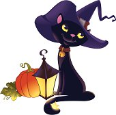 Halloween kitten with pumpkin and lantern