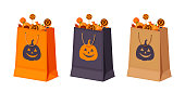 Halloween paper bags with candies. Vector illustration.