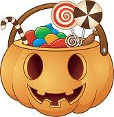 Halloween pumpkin basket with full of candies