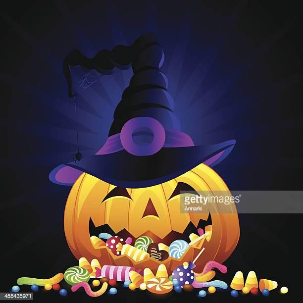A Halloween pumpkin with candy