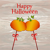 Halloween. Pumpkins on a sticks with a bows and ribbons. Vector. Greeting card / invitation to a party. Empty space for text or advertising.