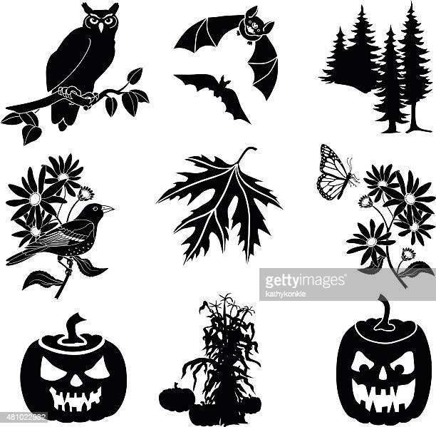 halloween vector icons in black and white - great horned owl stock illustrations