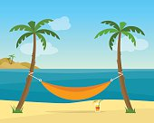 Hammock with palm trees on beach