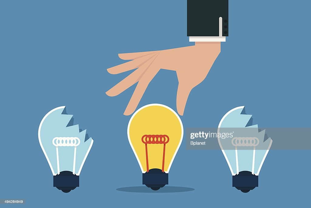 Hand choosing best idea bulb.