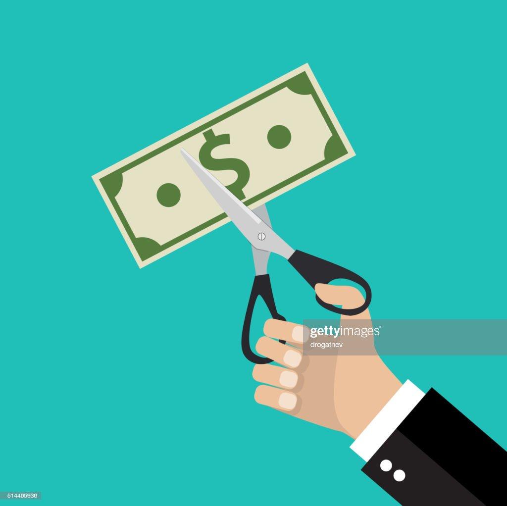 Hand cutting money bill in half with scissors.