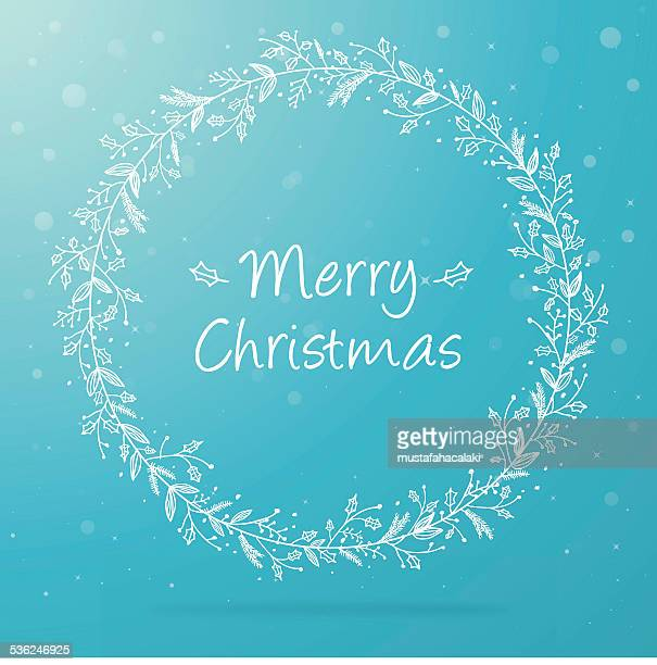 Hand drawn christmas wreath on blue background