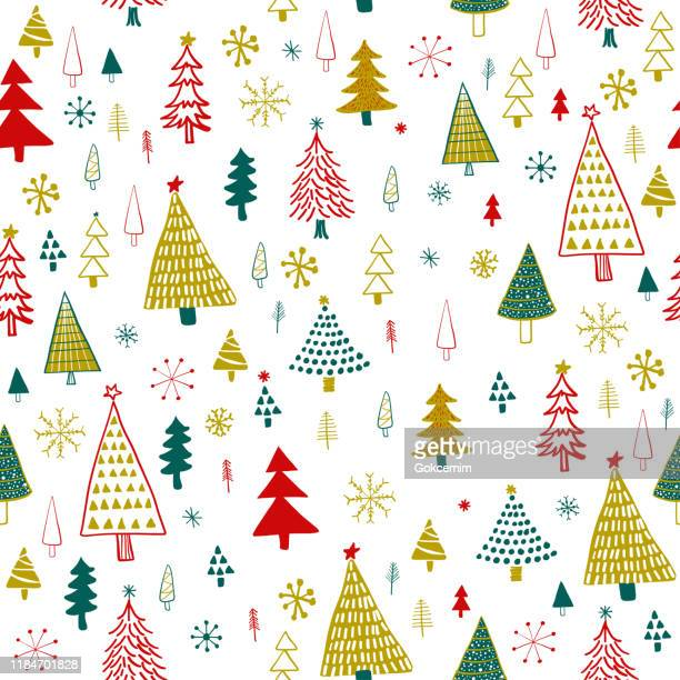 hand drawn christmas/holiday trees pattern. gold, green, red christmas trees, seamless pattern. forest background. childish texture for fabric, textile. - christmas paper stock illustrations