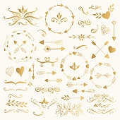 Hand drawn collection of golden stamps, wreaths and doodles.