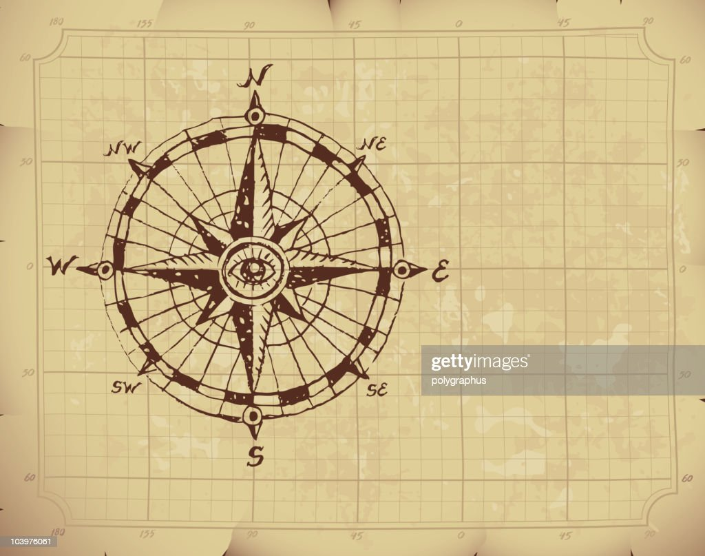 Hand drawn compass rose with an eye on the center