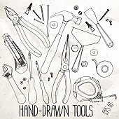 Hand drawn construction tools on craft paper