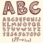 Hand drawn doodle folkloric ornamental alphabet with numbers.