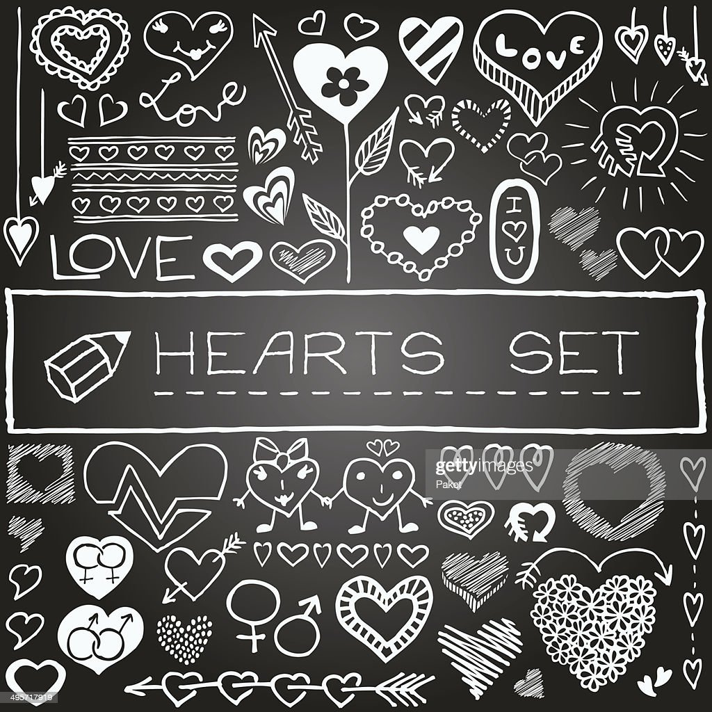 Hand drawn set of hearts and arrows with chalkboard effect.