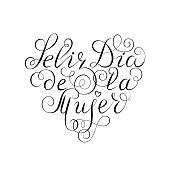 Hand drawn Spanish lettering. Happy Women's Day. Black ink calligraphy on white background. Heart shape. Used for greeting card, poster design. Feliz dia de la mujer.