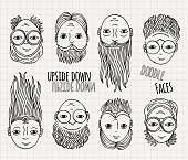 Hand drawn upside down doodle faces