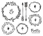 Hand drawn vintage ampersand, arrows and wreaths.