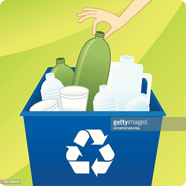 Hand dropping bottle into recycling bin
