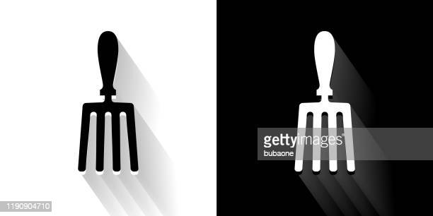 hand fork black and white icon with long shadow - garden fork stock illustrations