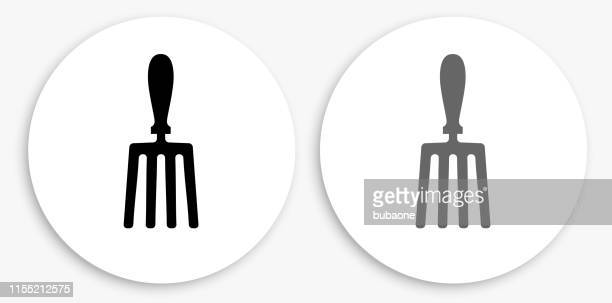 hand fork black and white round icon - garden fork stock illustrations
