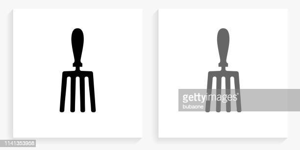 hand fork black and white square icon - garden fork stock illustrations