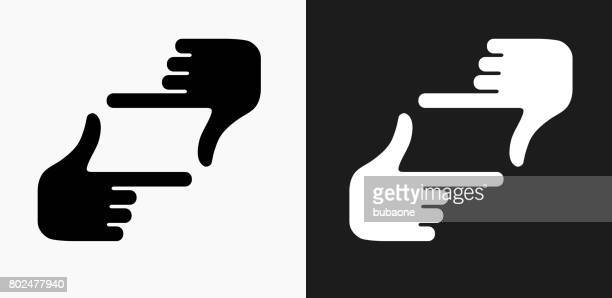Hand Framing Icon on Black and White Vector Backgrounds