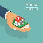 Hand giving house keys