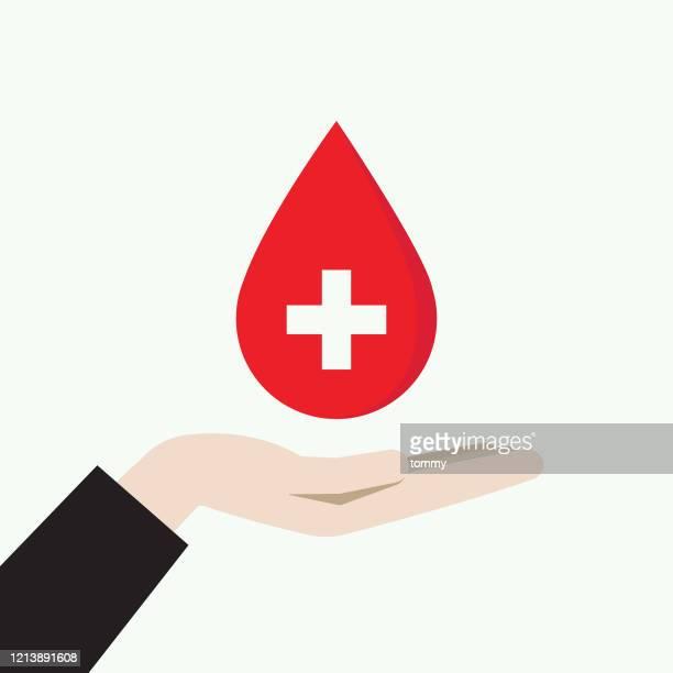 献血シンボルを手に持つ - 赤十字社点のイラスト素材/クリップアート素材/マンガ素材/アイコン素材