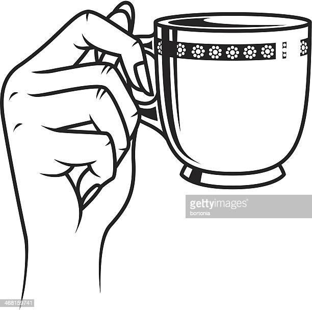 Manos sosteniendo una taza de café