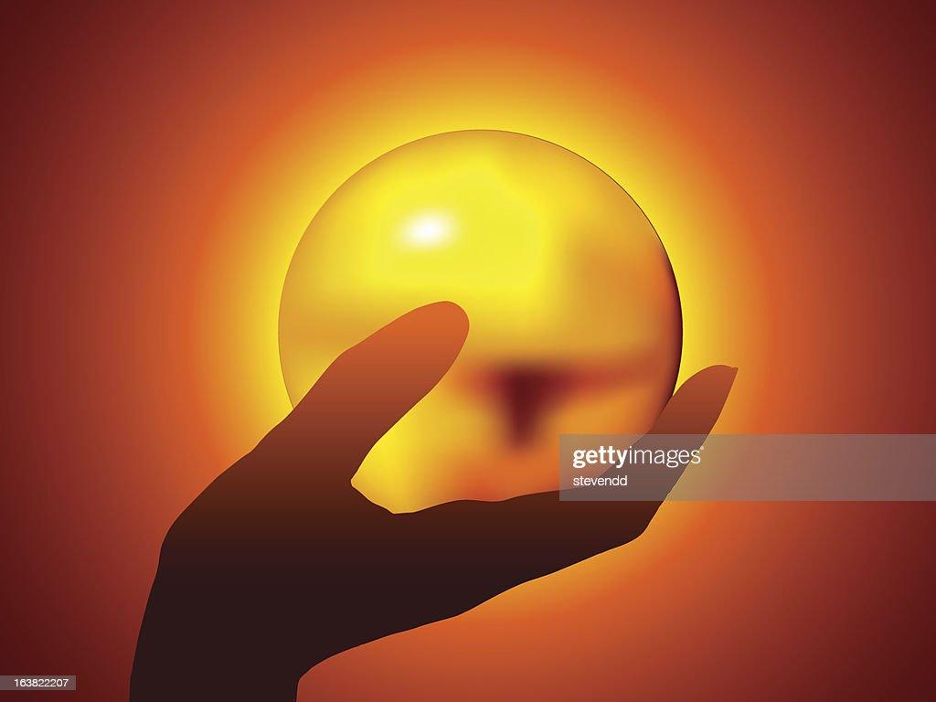 Hand holding a golden ball