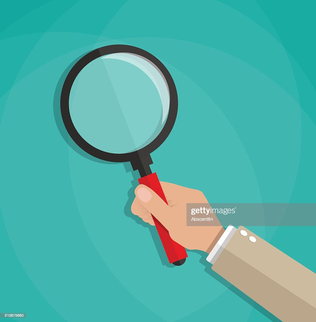 hand holding a magnifying glass