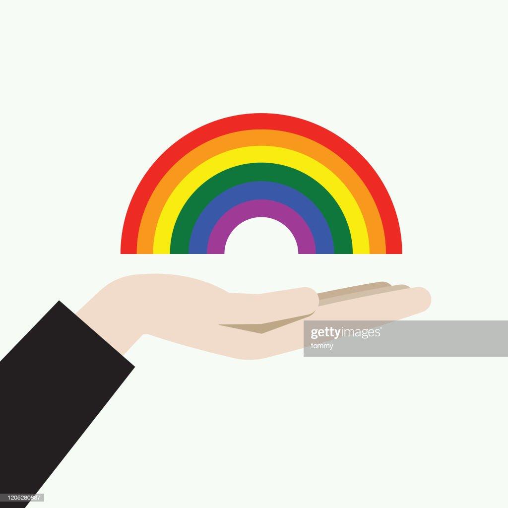 虹のシンボルを持つ手 : ストックイラストレーション