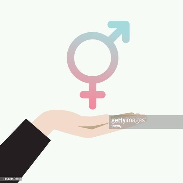 トランスジェンダーのシンボルを持つ手 - ゲイ点のイラスト素材/クリップアート素材/マンガ素材/アイコン素材